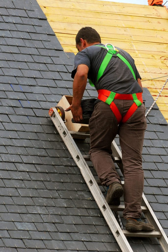 roofing expert installing new roof